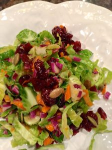 Brussel Sprout Salad with Pumpkin Seeds and Cranberries